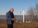 Larry Loyie burning sweetgrass in the cemetary in Grouard, Alberta, in memory.