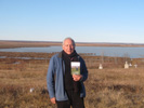 Larry Loyie with his book Goodbye Buffalo Bay overlooking Buffalo Bay.