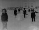 Larry 2nd from left and boys on ice rink with residential school, Grouard, AB