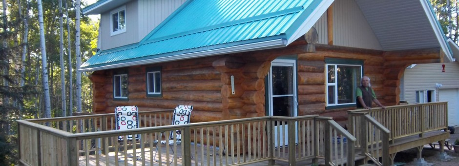 Larry Loyie at the log house in Alberta, a great place to write books....